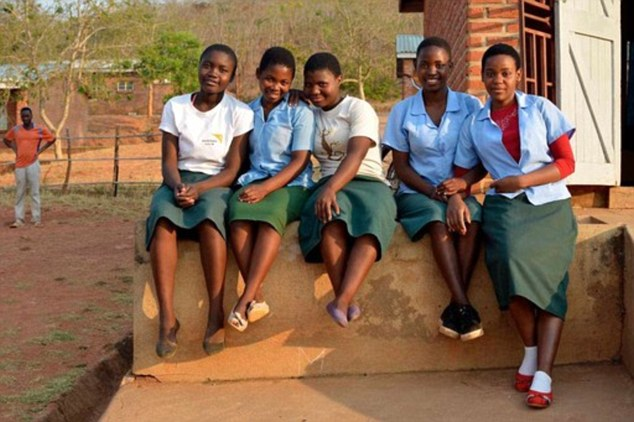 Nelly (centre) pictured with her school friends. The teen became a mother for the first time aged just 15 when she was befriended by an older man at a local market, and the pair married. He later became abusive; after fleeing the marriage, Nelly is back at school