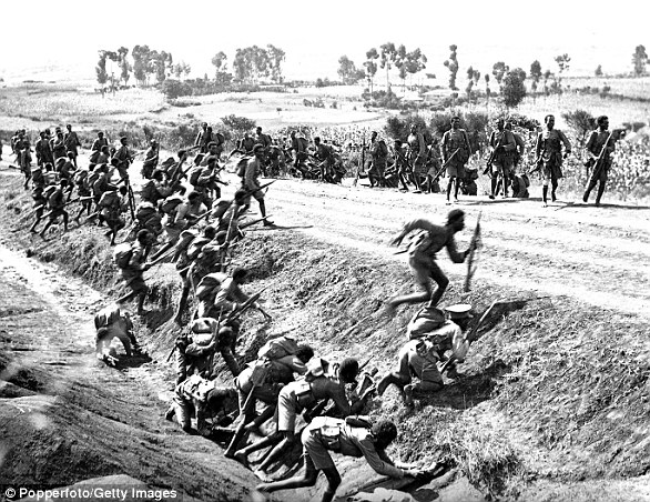 Abyssinian infantry scramble for cover as Italian warplanes attack Ethiopia's Ogaden region during bitter warfare in 1935