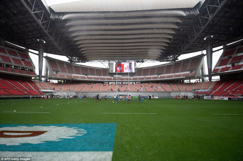 The stadium features an oddly-designed retractable roof (top), which folds in on itself like an accordion