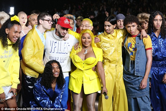 Success: Lil Kim and designer Paul Cupo were surrounded by models as they took a bow after the runway show