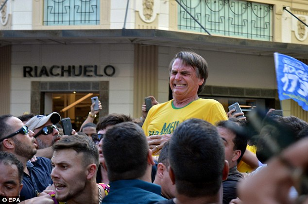 Then-presidential candidate Jair Bolsonaro reacts after being stabbed during a campaign rally in Juiz de Fore, Brazil, in 2018