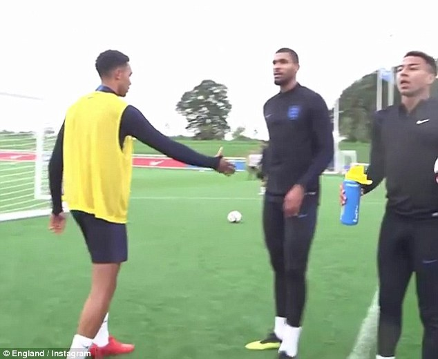 Following a kickabout in England training, Alexander-Arnold tries to shake their hands