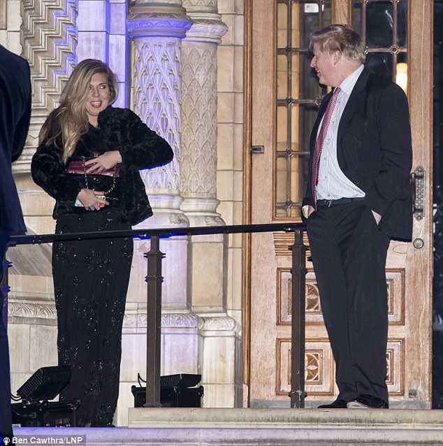 Carrie Symonds, left, and Boris Johnson, right, were photographed in February