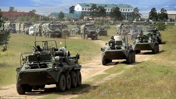 Hundreds of thousands of troops including Chinese soldiers are taking part in Russia's largest every military drills. Pictured, military vehicles during the exercises on Tuesday