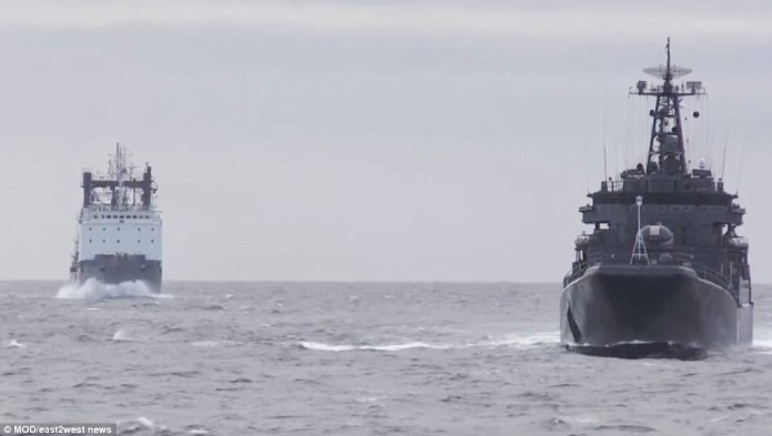 Several frigates equipped with Kalibr missiles that have been used in Syria during the games are seen in Russian waters on Tuesday