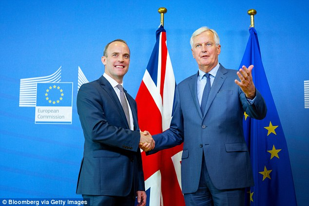 Dominic Raab, UK exiting the European Union secretary, left and Michel Barnier, chief negotiator for the European Union, shake hands following a news conference in Brussels, Belgium, on 31 August