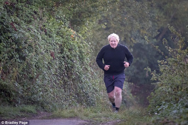 Mrs May has been under pressure over her Brexit plan with Boris Johnson (pictured running near his Oxfordshire home today) thought to be plotting a leadership challenge