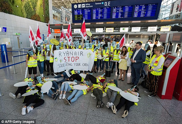 Ryanair suffered a 24-hour cabin crew and pilot strike in Germany prompting the cancellation of 150 out of 400 flights. Pictured is a picket line at Frankfurt Airport yesterday