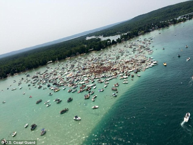 Apparently a sandbar party at Torch Lake in 2015 to mark Independence Day caused quite a stir when it attracted 10,000 party-goers