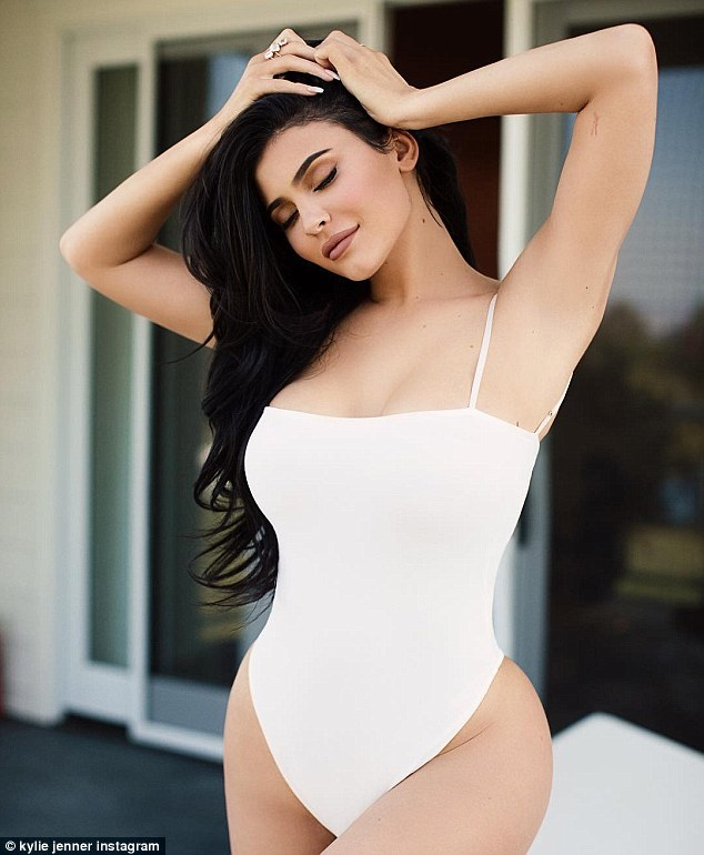 Looking great:She wowed in the shots, taken by photographer Sasha Samsonova, in the tiny one-piece with her hair jet black and loose around her