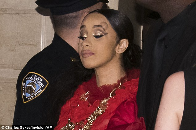 Bump on the noggin: During their NYFW melee, Cardi (born Belcalis Almanzar) flung her Gucci heels at a cowering Minaj and she sported a swollen knot after Nicki's bodyguards reportedly elbowed her forehead