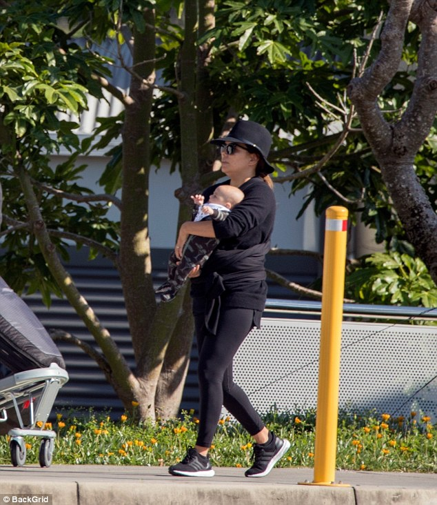 She's a natural! New mother Eva, who gave birth just 12 weeks ago, held her adorable son Santiago Enrique in her arms as she strolled the sidewalk