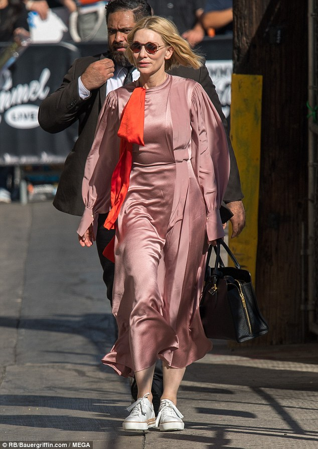 Pretty in pink: The 49-year-old actress stepped out in style for the occasion, wearing a flowing pink satin gown, which featured full billowing sleeves and a high neckline