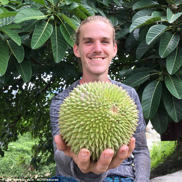 Simon (pictured with a durian fruit in Bali) explained how he decided to go fruitarian while training for a marathon, and becoming inspired by a frutiarian athlete