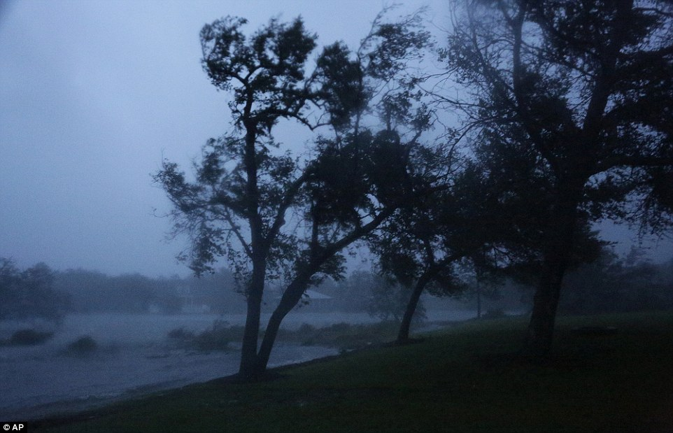 Visibility is poor around the eye of the storm, as water and other debris is pulled up into the air by the wind, as seen in this image of Swansboro on Friday