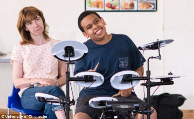 Each child had two 30-minute drumming session aimed at being fun, delivered by tutors using electronic kits provided by charities in Gloucestershire (pictured, one of the children and their tutor involved in the study)