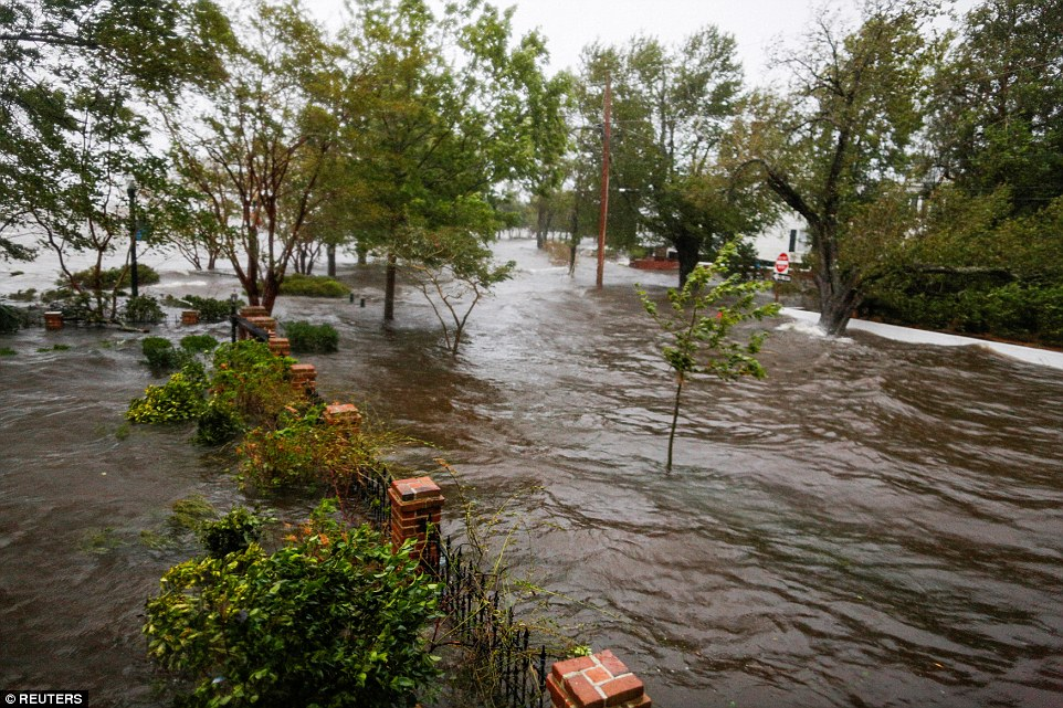 Water from the Neuse river floods the streets during the passing of Hurricane Florence in the town of New Bern