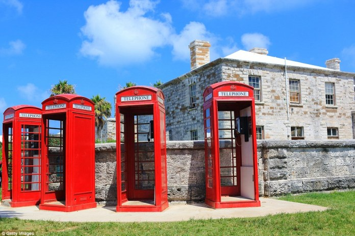 Red phone boxes at the Royal Navy Dockyard in Bermuda are an interesting contrast to the pristine beaches nearby
