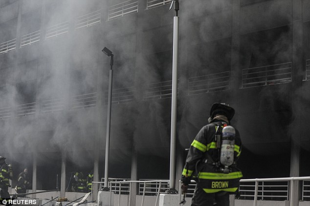 Smoke billows out of the Kings Plaza Shopping Center Monday morning