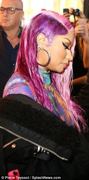 Wet look:Hairstylist Dionte Gray coiffed the former American Idol judge's pink-and-purple wig while Mali Magic applied her fully-contoured complexion and false lashes