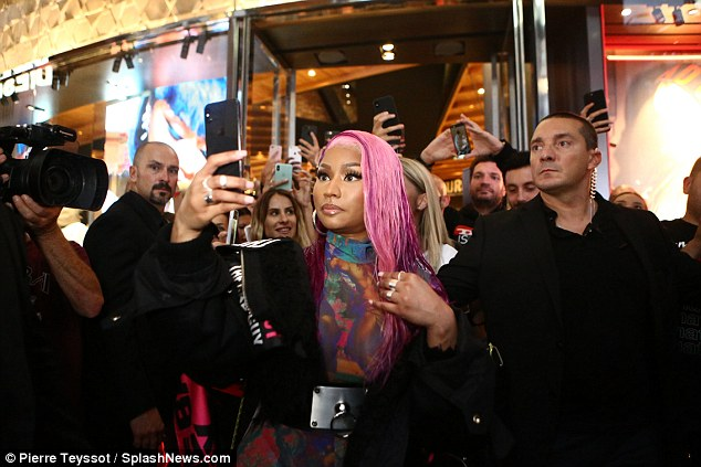 Selfie: Throughout her promotional appearance, Nicki (born Onika Maraj) captured all of the fan-screaming action for her captive, combined 152.7M social media following