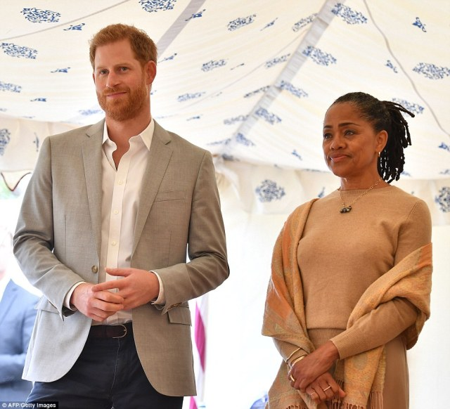 The prince stood with his proud mother-in-law at the event