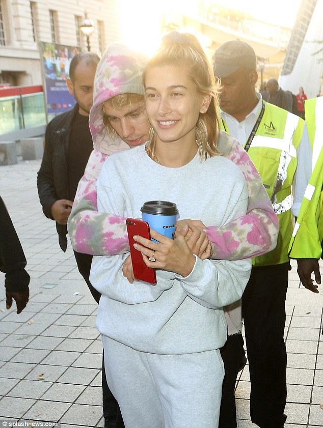 Flashing her $500K engagement ring: The disheveled former YouTube sensation is currently vacationing in London with Hailey Baldwin after the couple secured their marriage license at a New York courthouse on September 13