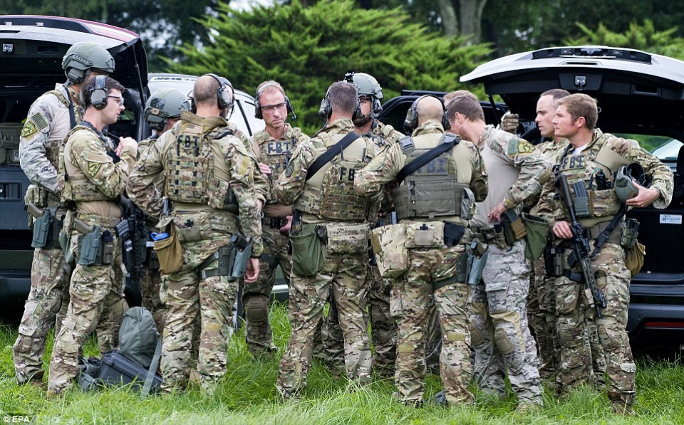 A team of tactical agents gather at the scene of the workplace shooting on Thursday morning in Aberdeen, Maryland