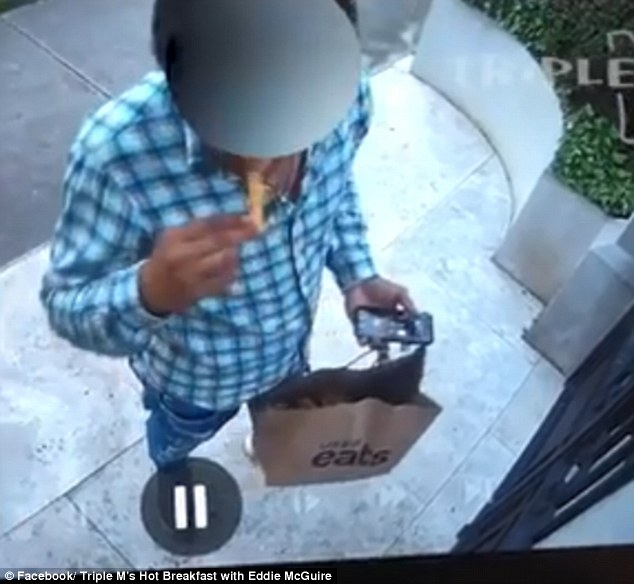 Moment a brazen UberEats driver is caught helping himself
