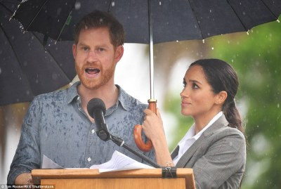 Earlier Meghan held an umbrella up for her husband Prince Harry as the rain poured down while he gave a speech in Dubbo