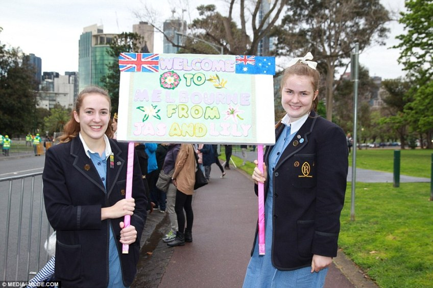 Two Melbourne schoolgirls are pictured with a welcome sign ahead of Prince Harry and Meghan's arrival in Melbourne