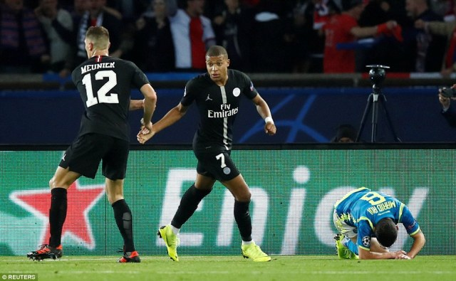 A dejected Rui (right) falls to the floor as Meunier (left) and Kylian Mbappe celebrate drawing level with Napoli