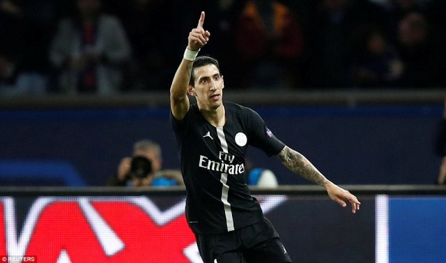 Angel Di Maria wheels away in celebration after scoring a late equaliser in his side's clash with Napoli on Wednesday night