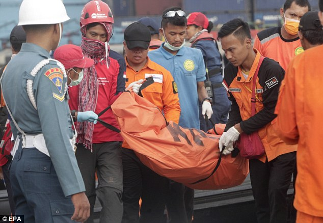 Indonesian emergency services carry a body bag in the wake of the Lion Air disaster last year