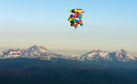 Modified deckchair carries man in 200mile helium balloon
