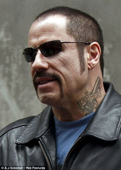 Tough guy: John Travolta gets a tattoo and handlebar moustache for his role