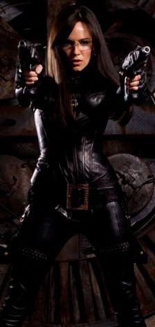 Sienna Miller straps on the leather for guntoting GI Joe