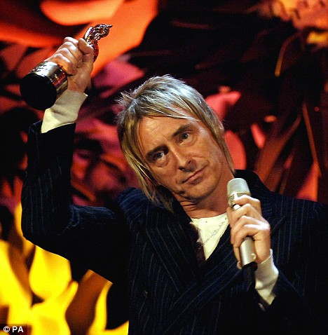 Paul Weller collects his award for Outstanding Contribution to Music at the Brit Awards in 2006