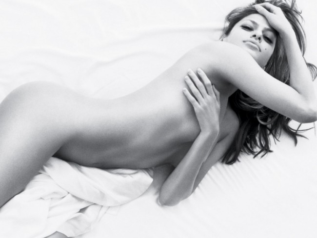 In the black and white advert a mostly bare Eva rolls around seductively in