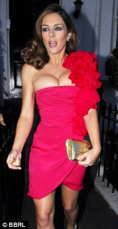 As she spills out of her garish fuschia dress why on earth is Liz Hurley going for the Jordan