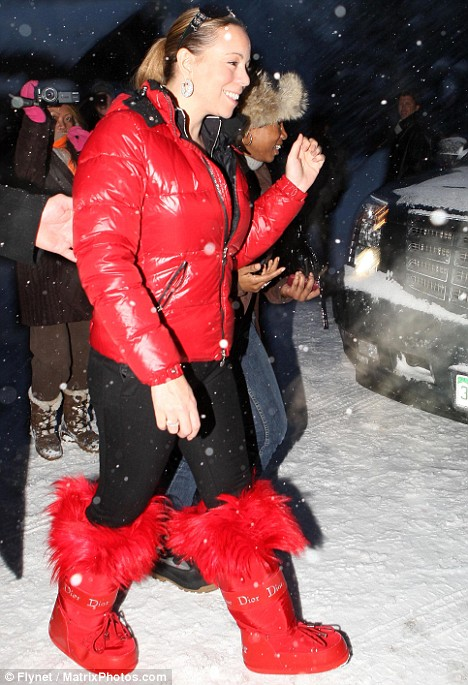 Mariah Carey leads the rush of stars to Aspen in festive red snow boots by Christian Dior of