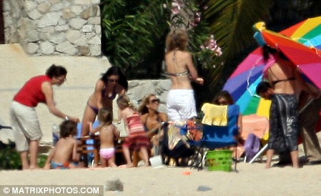 Courtney Cox and Jennifer Aniston spent the day on the beach in Mexico with children and friends including Laura Dern
