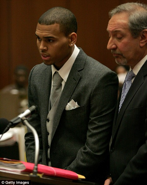 Charged with assault: Chris Brown answers questions in the Superior Court of Los Angeles County as his Attorney Mark Geragos (R) looks on