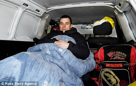 Businessman sleeps in his van for two nights to stop