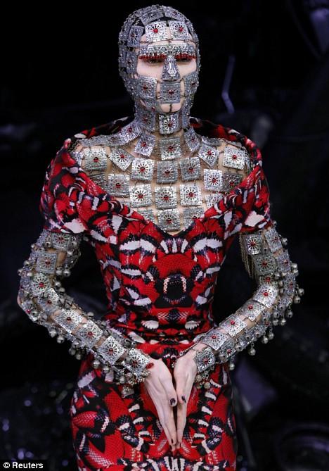 A model wears a creation by British designer Alexander McQueen