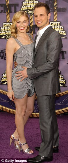 Singer LeAnn Rimes (L) and husband Dean Sheremet