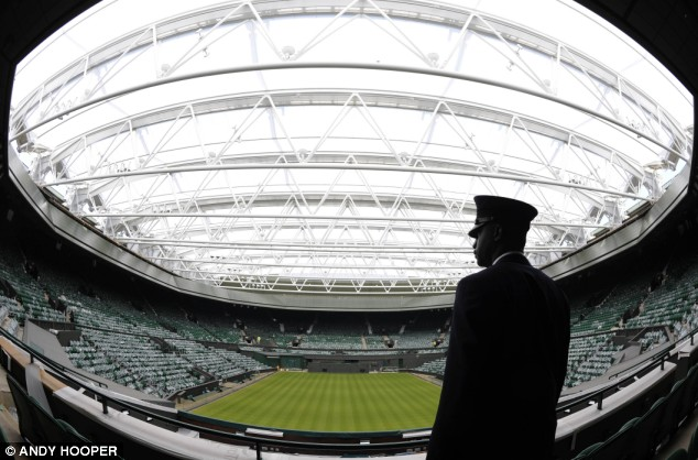 A Wimbledon official admires the renovated Centre Court at SW19