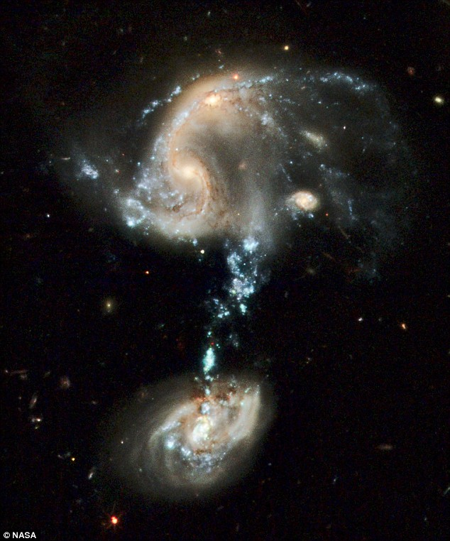 Punctuation mark in the heavens. The scientific name for the galaxies linked by a stream of glowing superstars is Arp 194