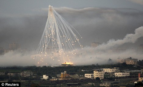 A white phosphorus shell fired by the Israeli military explodes over the Gaza strip earlier this year. The chemical ignites on contact with the air, and causes severe burns. The US is accused of using the weapon illegally in Afghanistan