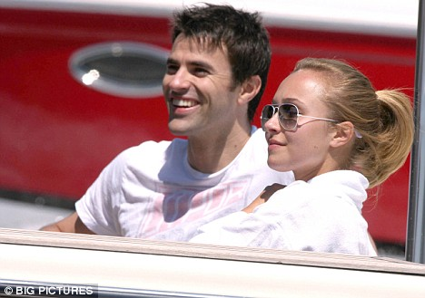 Actress Hayden Panettiere cuddles and laughs with T4 presenter Steve Jones